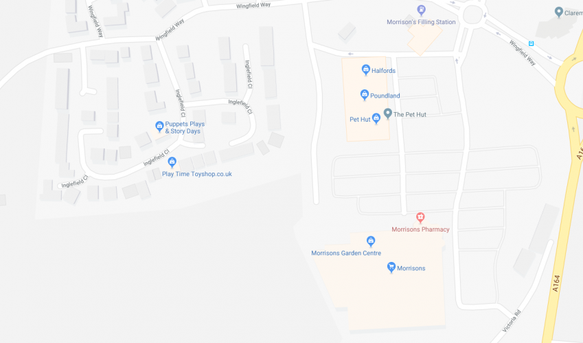 screenshot showing local shops and residential estate on google maps